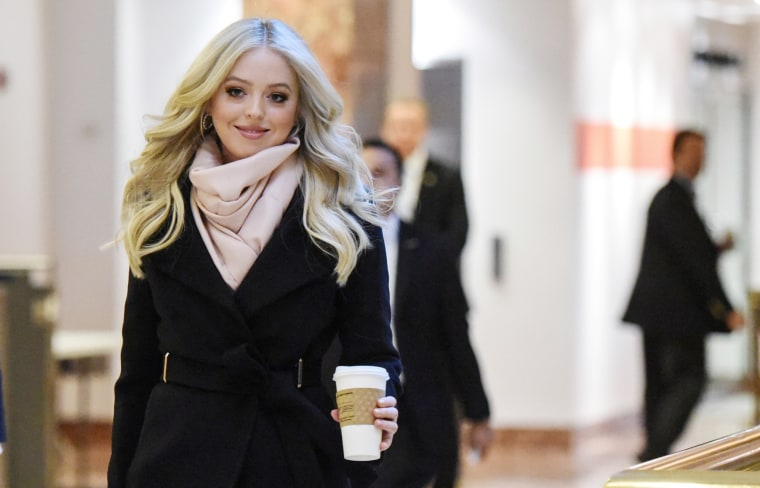Image: Tiffany Trump passes through the lobby at Trump Tower in New York City
