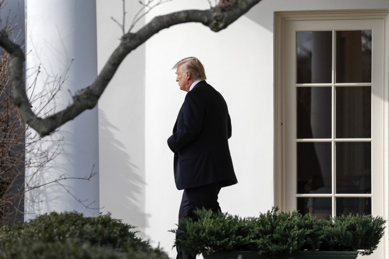 Image: Trump walks out of the Oval Office to board Marine One