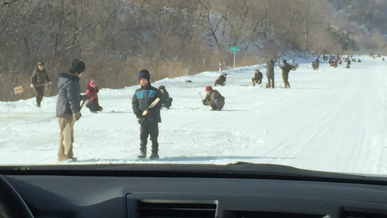 Image: Some of the North Koreans clearing the route near the ski resort.