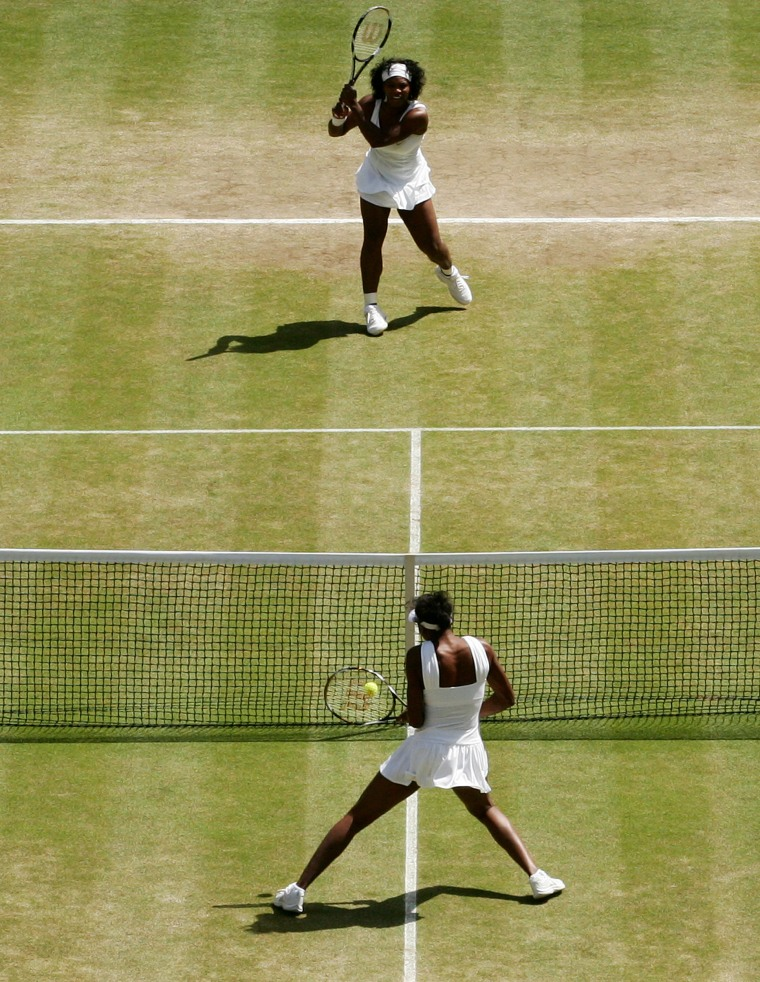 Image: Venus and Serena Williams play against each other at Wimbledon in 2008