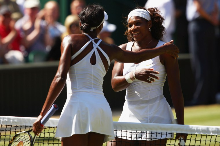 Image: Venus and Serena Williams at Wimbledon in 2009