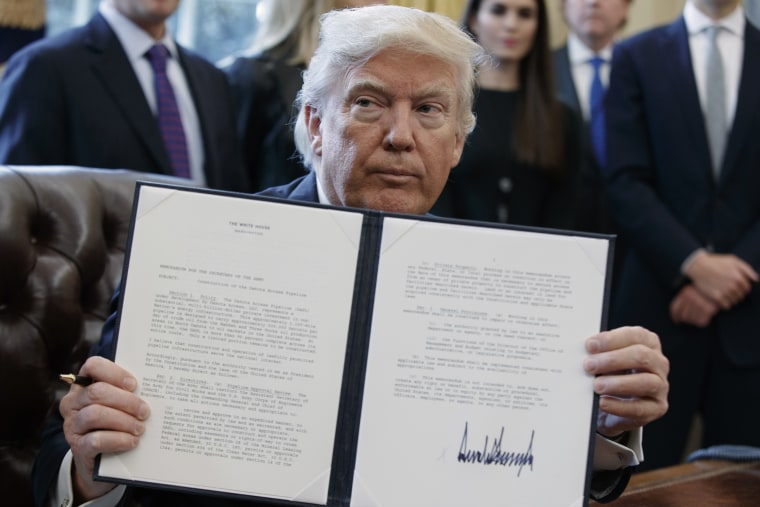 Image: President Donald Trump shows off his signature on an executive order about the Dakota Access pipeline,Jan. 24, 2017.