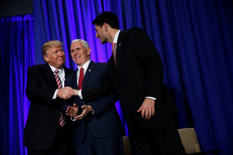 Image: President Donald Trump is greeted by Vice President Mike Pence and House Speaker Paul Ryan (R) as he arrives to speak at a congressional Republican retreat in Philadelphia, Jan. 26.