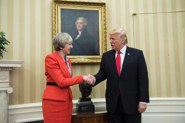 Image: British Prime Minister Theresa May (L) and US President Donald Trump meet beside a bust of former British Prime Minister Winston Churchill in the Oval Offic
