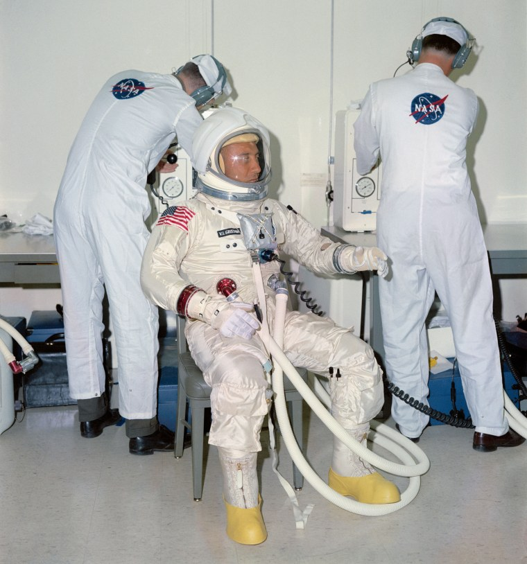 Virgil I. Grissom test his spacesuit ahead of the mission.