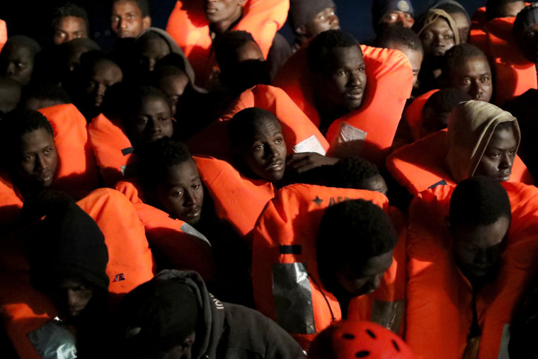 Image: Migrants are aboard an overcrowded raft as the former fishing trawler Golfo Azzurro of the Spanish NGO Proactiva Open Arms approaches during a rescue operation, in the central Mediterranean Sea, 24 miles north of the Libyan coastal city of Sabratha