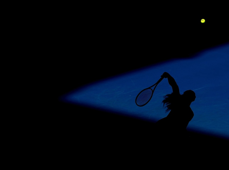 Image: Serena Williams of the United States serves in her semifinal match