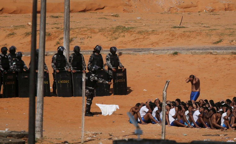 Image: Riot policemen do a head count of inmates during an uprising at Alcacuz prison in Natal