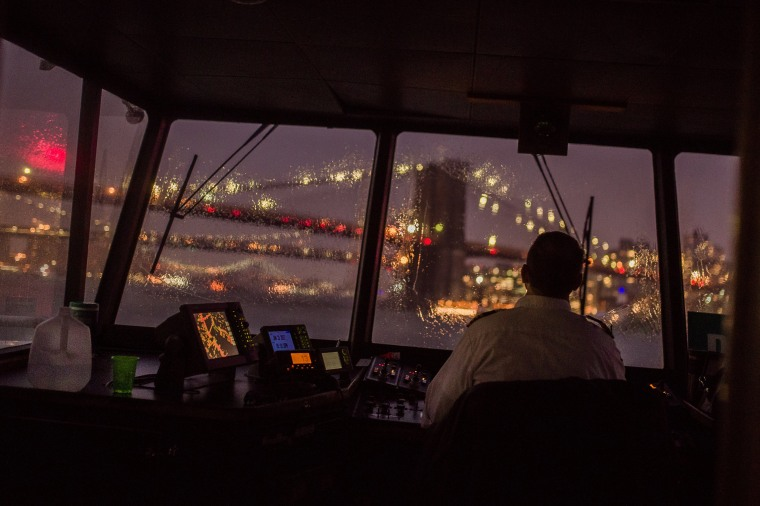 Image: A ferry travels on the East river from Manhattan to Brooklyn during a storm in New York