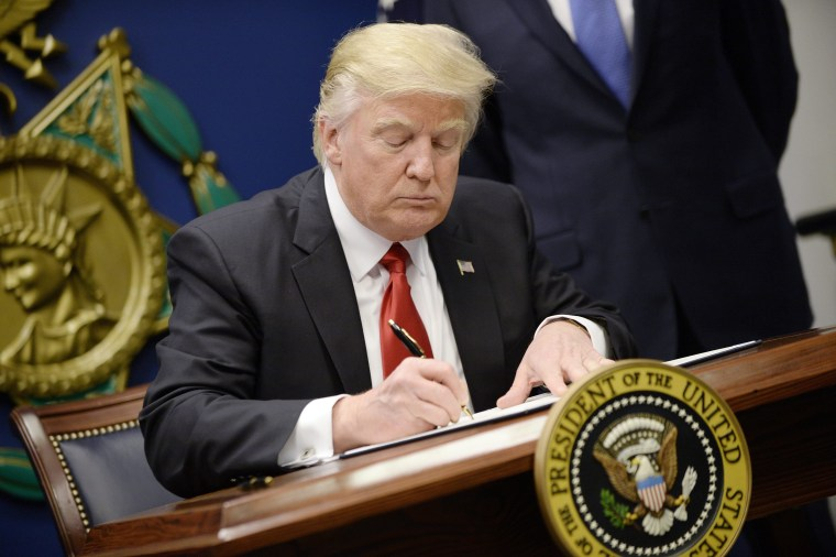 Image: President Donald Trump signs Executive Orders in the Hall of Heroes at the Pentagon in Arlington, Virginia on Jan. 27.