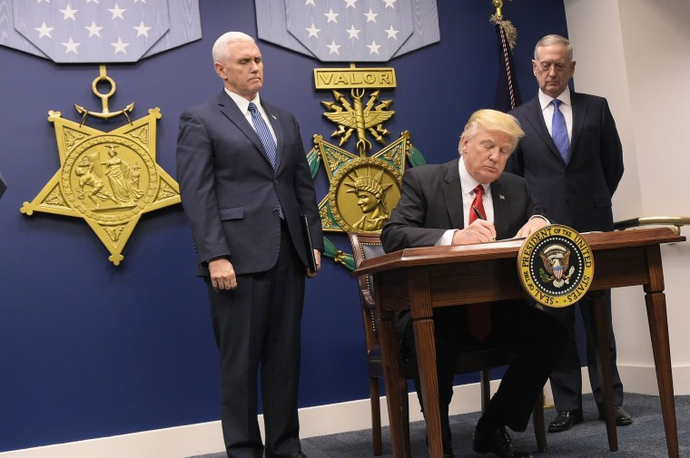 Image: President Trump signs an executive order alongside Defense Secretary Mattis and Vice President Pence on Jan. 27 at the Pentagon in Washington, D.C.