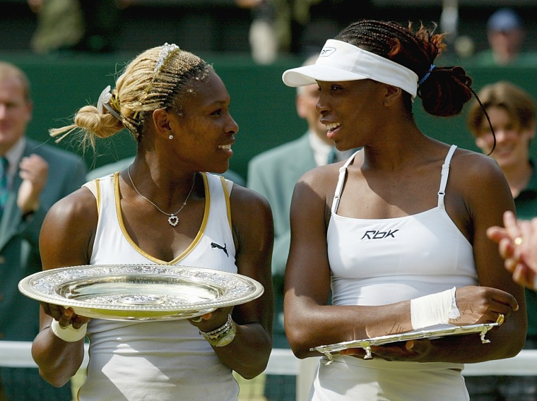 Image: 2002: Serena Williams celebrates her victory against her sister Venus after the women's singles final at the All England Tennis Championships at the All England Lawn Tennis Club in Wimbledon, England on July 6.