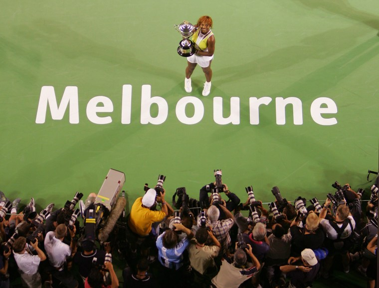 Serena Williams of the US holds 2005 Australian Open tennis trophy after win over compatriot ...