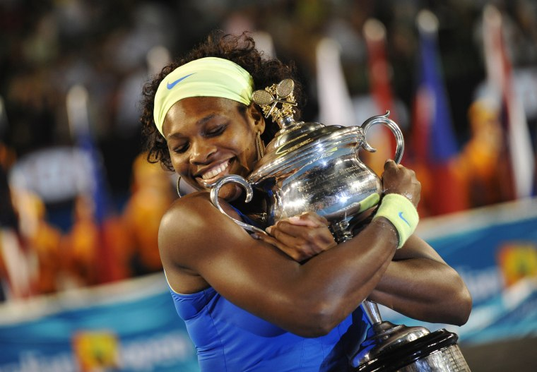 Image: 2009: Serena Wiliams holds the winner's trophy after her game against Dinara Safina of Russia in their women's tennis final match of the Australian Open in Melbourne on Jan. 31. Williams beat Safina to win her fourth Australian Open title, bringing