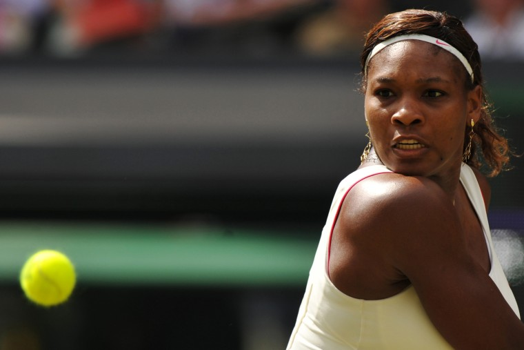 Image: 2010: Serena Williams returns a ball to Russia's Vera Zvonareva in the women's final during the Wimbledon Tennis Championships in London on July 3. Williams defeated Zvonareva to win her fourth Wimbledon title.