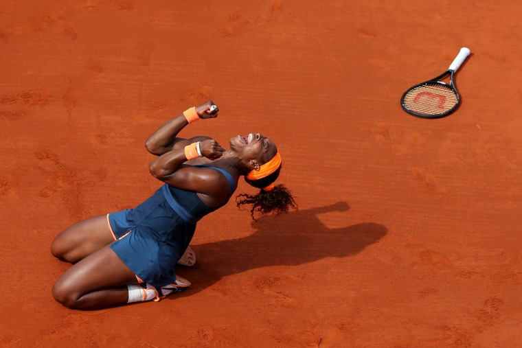 Image: 2013: Serena Williams celebrates match point in her women's singles final match against Maria Sharapova of Russia during the French Open at Roland Garros in Paris, France on June 8.