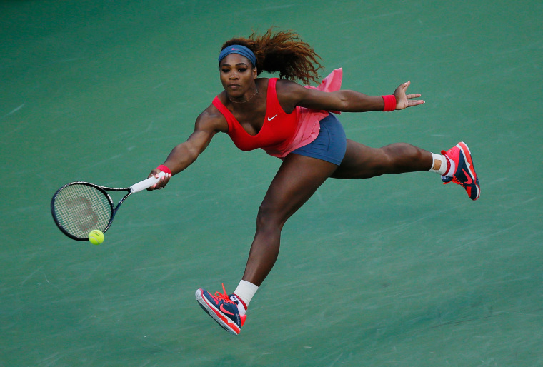 Image: 2013: Serena Williams returns a shot during her women's singles final match against Victoria Azarenka of Belarus during the 2013 US Open at the USTA Billie Jean King National Tennis Center in New York City on Sept. 8.