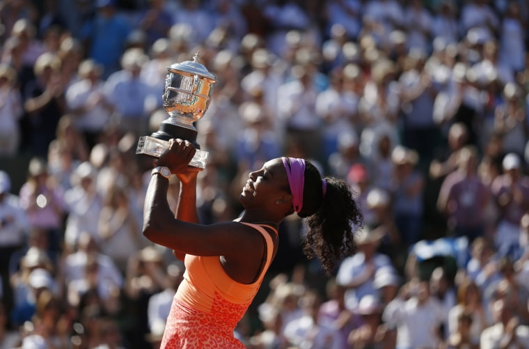 Image: 2015: Serena Williams poses with the trophy during the ceremony after defeating Lucie Safarova of the Czech Republic during their women's singles final match to win the French Open tournament at the Roland Garros stadium in Paris on June 6.