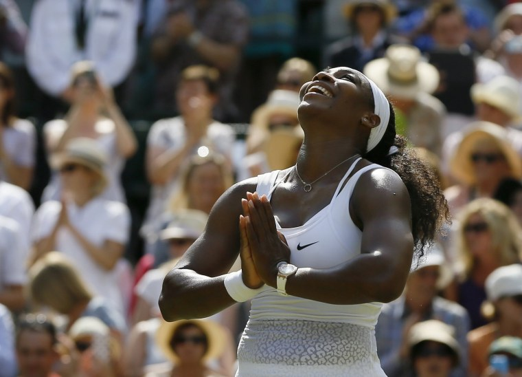 Image: 2015: Serena Williams celebrates winning the singles match against Garbine Muguruza of Spain at the All England Lawn Tennis Championships in Wimbledon, London on July 11.