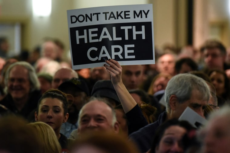 Image: People demonstrate for the Affordable Care Act and against Trump during the First Stand Rally in Newark