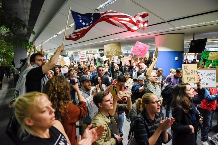 Image: Demonstrators shout slogans during anti-Donald Trump immigration ban protests inside Terminal 4 at San Francisco International Airport in San Francisco