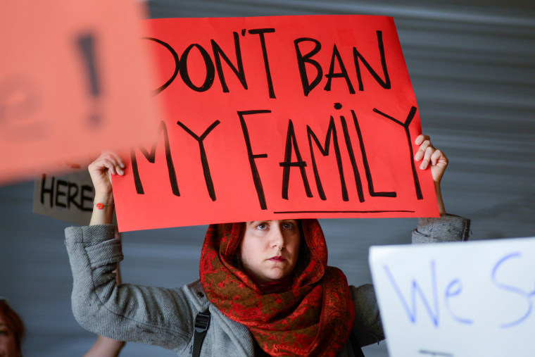 Image: Demonstrators shout slogans during anti-Donald Trump immigration ban protests outside Terminal 4 at San Francisco International Airport in San Francisco