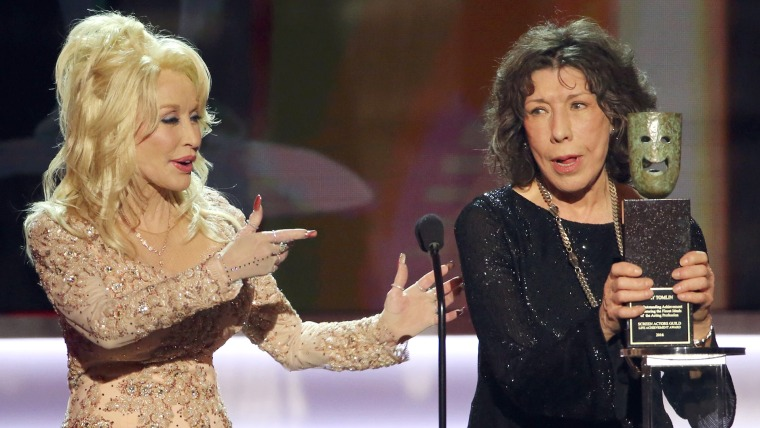 Lily Tomlin is congratulated by Dolly Parton after she was presented with the Life Achievement Award during the 23rd Screen Actors Guild Awards in Los Angeles
