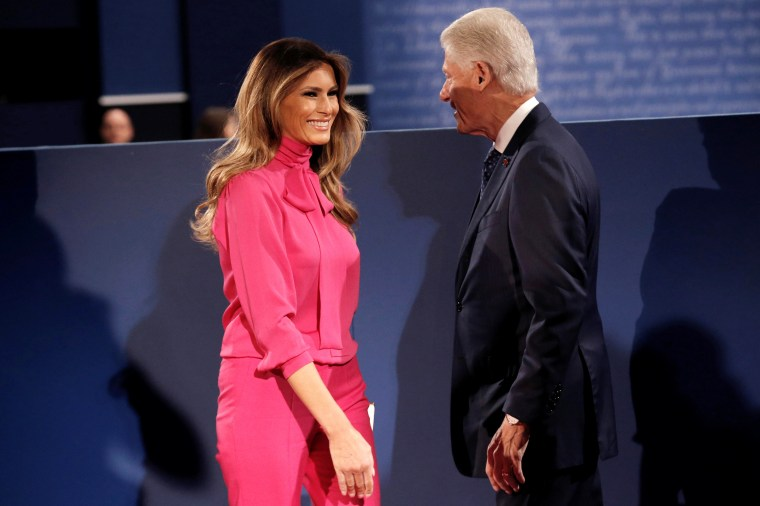 Former U.S. President Bill Clinton and Melania Trump greet each other before Republican U.S. presidential nominee Donald Trump and Democratic U.S. presidential nominee Hillary Clinton begin their presidential town hall debate at Washington University in St. Louis, Missouri, October 9, 2016.
