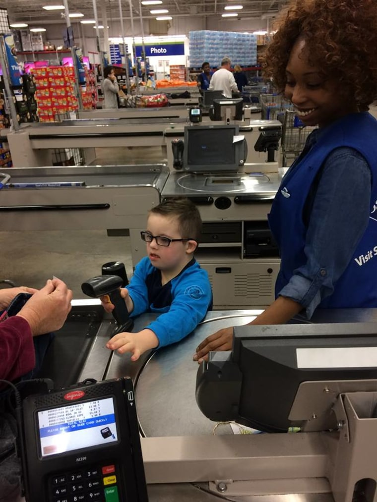 Carter helps out at the cash register