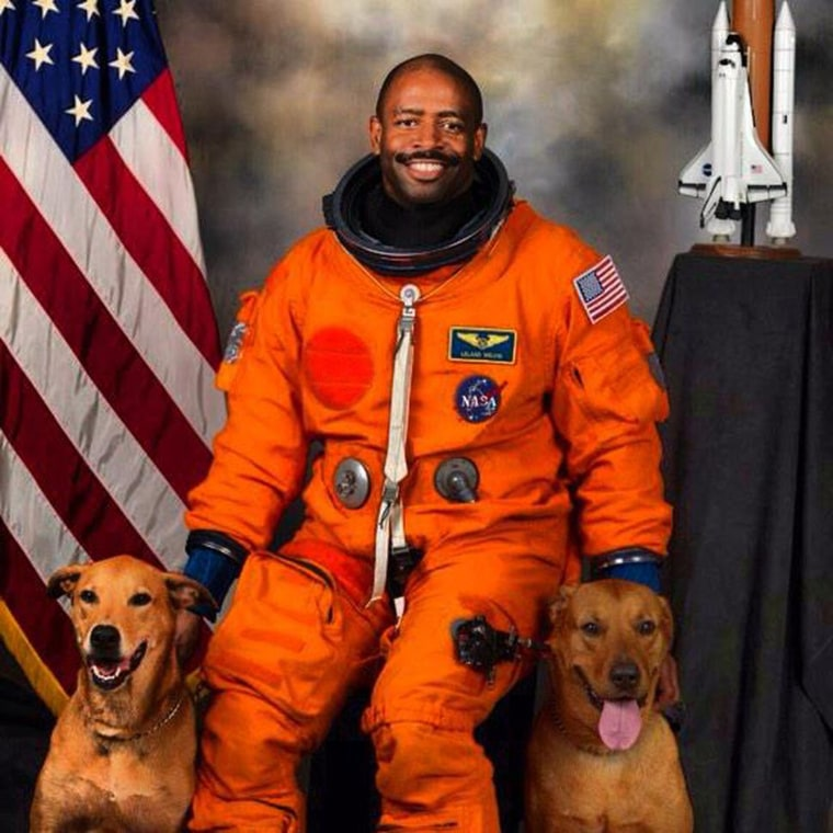 Astronaut Leland Melvin with his rescue dogs Jake and Scout.
