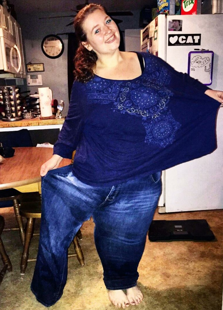 After losing 236 pounds in a year, Lexi Reed can fit into one leg of the jeans she wore when she weighed 485 pounds. She hopes to continue losing and being healthy.
