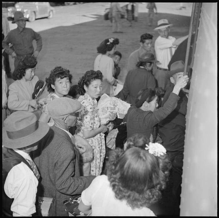 The last of the residents of the Amache concentration camp board the train at Granada, Colorado for the return journey to the west coast or to new homes elsewhere in the country.