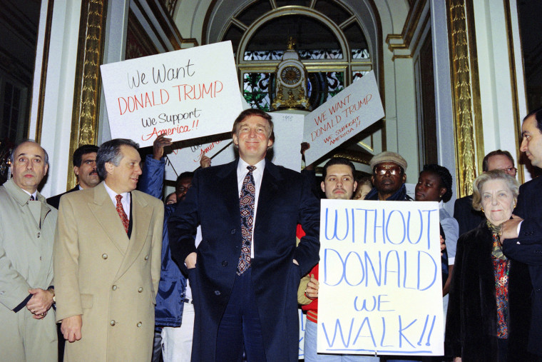 Image: Donald trump enters the Plaza Hotel past supporters in 1994