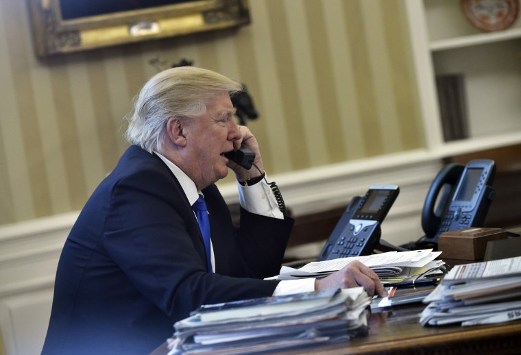 Image: US President Donald Trump speaks on the phone with Germany's Chancellor Angela Merkel from the Oval Office