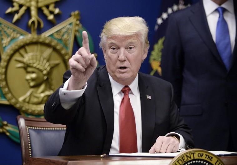 Image: US President Donald Trump signs Executive Orders at the Pentagon in Arlington, Virginia
