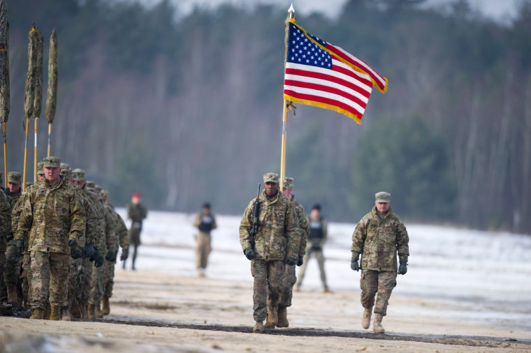 Image: U.S. soldiers march with their flag in Zagan, Poland