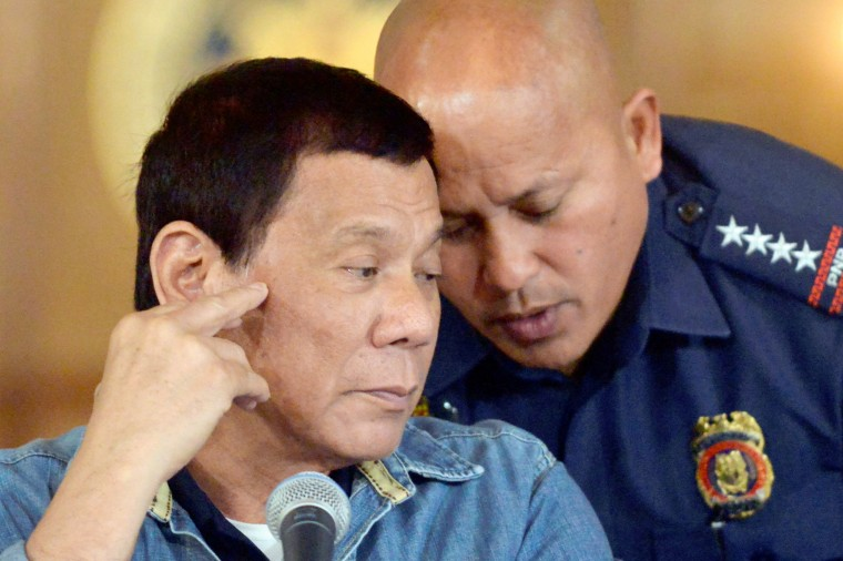 Image: Philippine President Rodrigo Duterte listens as Philippine National Police Director General Ronald Dela Rosa whispers to him, during a late night news conference at the presidential palace in Manila, Philippines, Jan. 29, 2017.