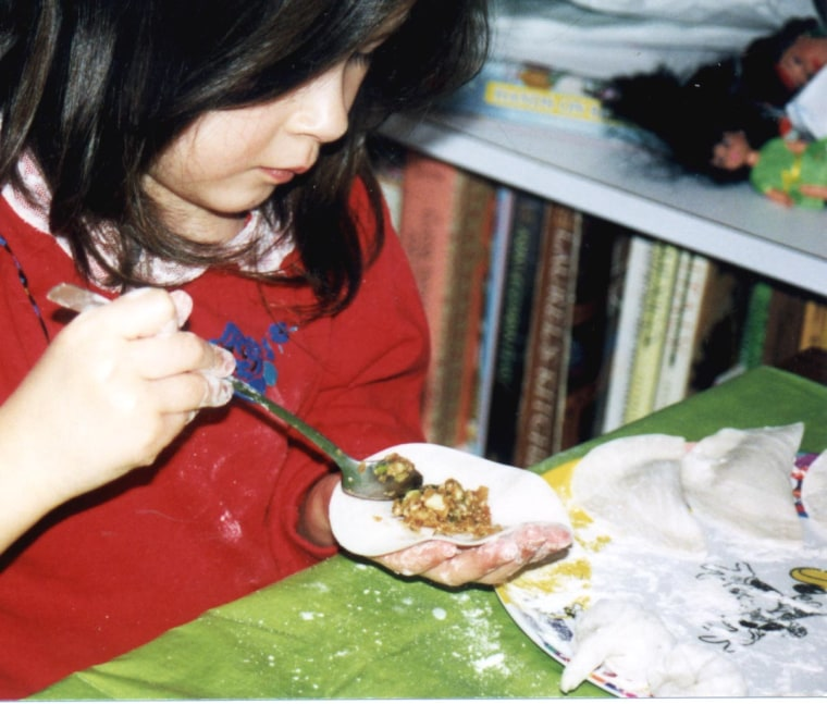 Frances Kai-Hwa Wang's daughter making dumplings for the Chinese New Year.