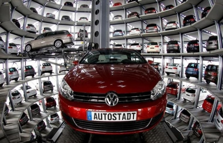 Volkswagen models Golf Cabriolet and Passat are stored at the CarTowers next to the Volkswagen plant in Wolfsburg
