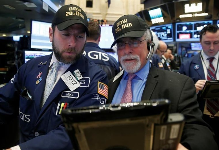 Traders work on the main trading floor of the NYSE as the Dow Jones Industrial Average passes 20,000 after opening of trading session in New York