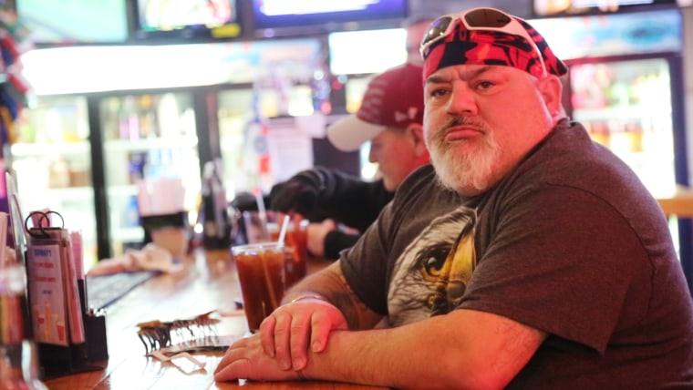 Image: Ronald Curry Jr., sits at the counter at the Joker's Bar and Grill in Funkstown, Maryland