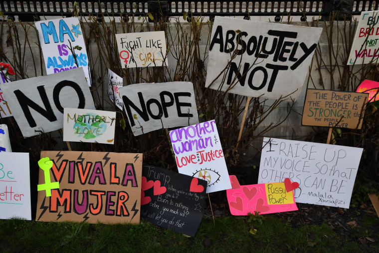 Image: Placards are left discarded in the garden of the National Gallery at the end of the Women's March in London on Jan. 21, 2017.