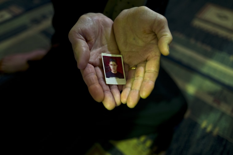 Image: In this Jan. 17, 2017 photo, Suad Abdulmajeed, 57, a Syrian refugee from Al-Qamishly, shows a photograph of her son Ayaz.