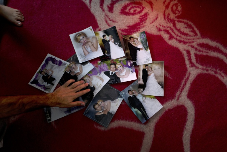 Image: In this Jan. 11, 2017 photo, Sheikhmous Hussein, 33, a Syrian refugee from the northern district of Al-Ashrafiya, Aleppo, shows photographs from his wedding day.
