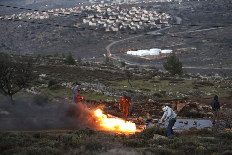 Image: TOPSHOT-CORRECTION-ISRAEL-PALESTINIAN-SETTLEMENT-CONFLICT