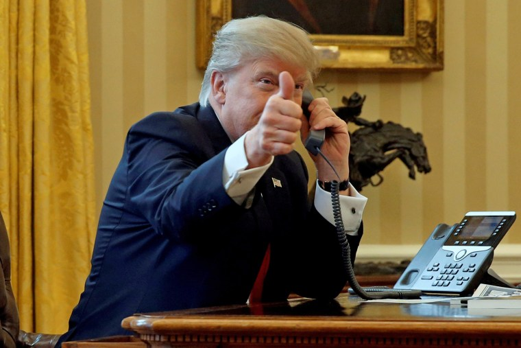 Image: File photo of U.S. President Trump giving a thumbs-up to reporters as he waits to speak by phone with the Saudi Arabia's King Salman in the Oval Office at the White House in Washington