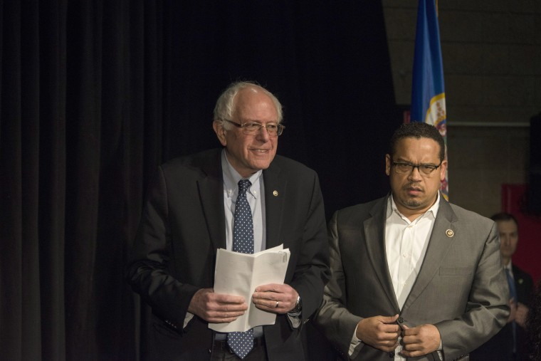 Image: Rep. Keith Ellison (D-MN), right, introduces Democratic presidential candidate Sen. Bernie Sanders (D-VT) wait to speak at a forum on Feb. 12, 2016 in Minneapolis, Minn.