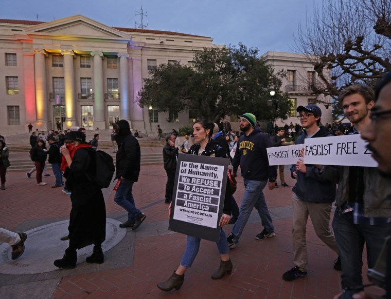 Image: People march in front of Sproul Hall to protest the appearance of Breitbart News editor Milo Yiannopoulos
