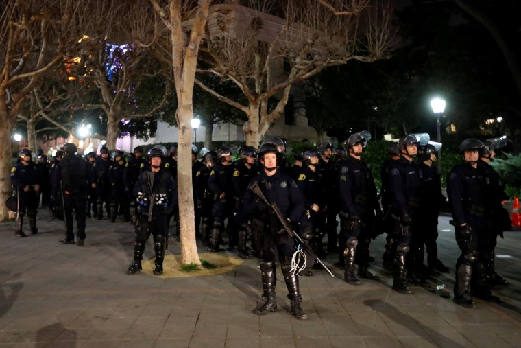 Image: Police officers prepare to deploy a skirmish line at UC Berkeley