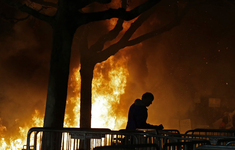 Image: A bonfire set by demonstrators protesting a scheduled speaking appearance by Breitbart News editor Milo Yiannopoulos burns on Sproul Plaza on the University of California at Berkeley campus on Wednesday, Feb. 1, 2017, in Berkeley, Calif.
